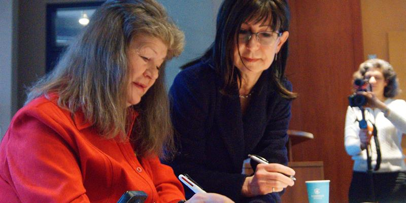 R-PATH Chair Cathy Birch and TCHC President and CEO Kathy Milsom sign the Building Standards for Accessibility document
